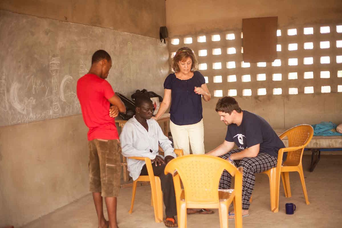 Team praying with Jeanaway